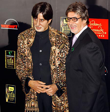 Amitabh Bachchan (right) poses beside his wax statue at Madame Tussaud's, London