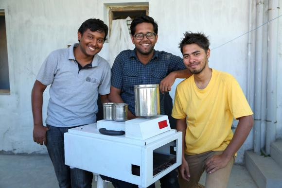 Eeshwar K Vikas, Sudeep Sabat and Sudarshan Lodha with their dosa machine