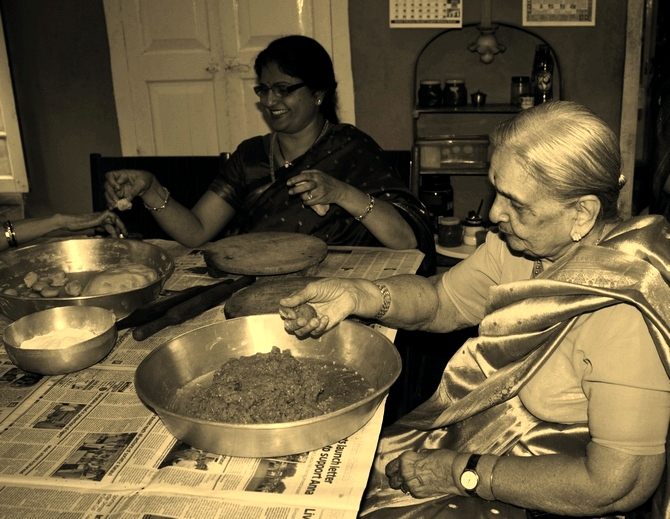 The author's grandmother (R) Sarala Kamalakar Rao Kulkarni pictured in 2011 helping make modaks.