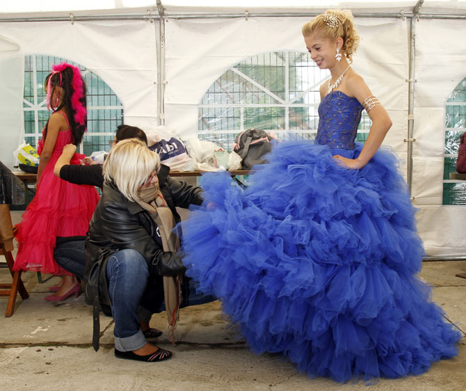 France wants to ban child beauty pageants. Seen here is a contestant preparing for the 'Mini-Miss' elegance beauty contest in Bobigny, near Paris.