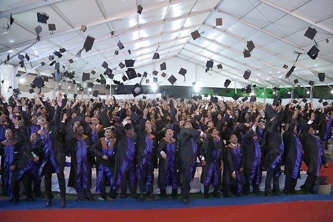 Students of ISB Hyderabad toss their hats in the air on their Graduation Day.