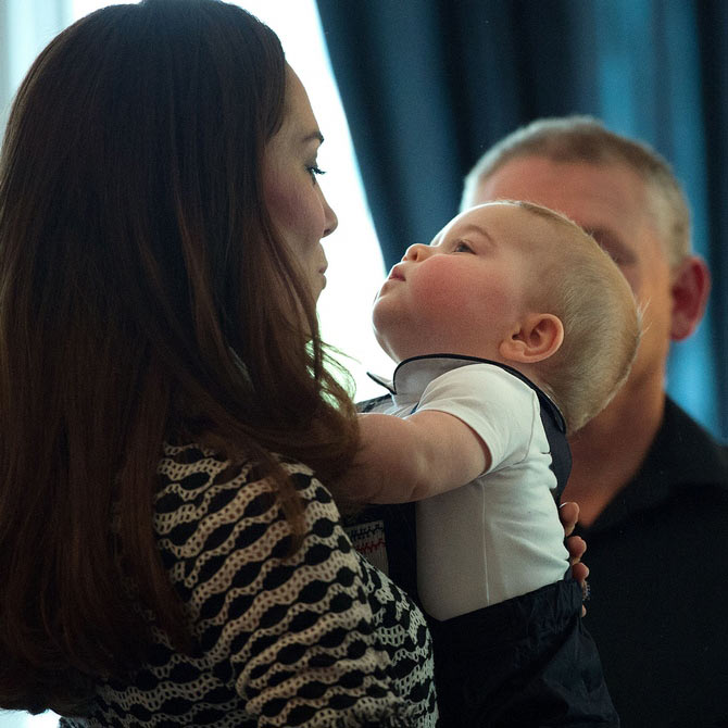 Here she is with Prince George, whose adorable frown has been the topic of many memes :-)