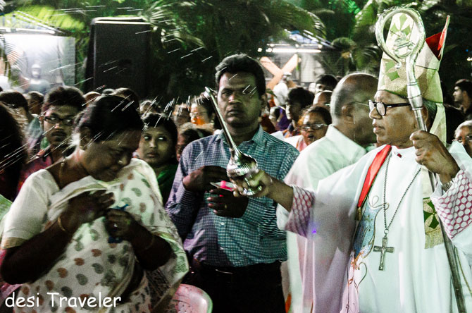 Archbishop Thumma Bala (extreme right) blesses the people who attended the mass.