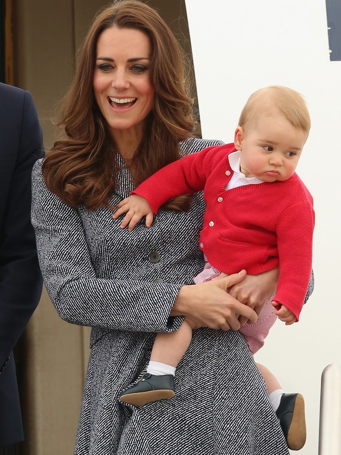 The Duchess of Cambridge holds Prince George of Cambridge as they leave Fairbairne Airbase to head back to the UK after finishing their Royal Visit to Australia.