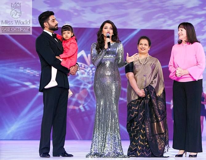 Aishwarya Rai Bachchan -- who was felicitated for being the most successful Miss World at the 2014 pageant -- with husband Abhishek Bachchan, daughter Aaradhya, mother Vrinda Rai and Miss World organiser Julia Morley in London. Photograph: Kind courtesy, missworld.com