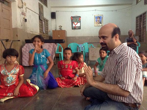 Anil Srinivasan teaching Carnatic music to underprivileged children