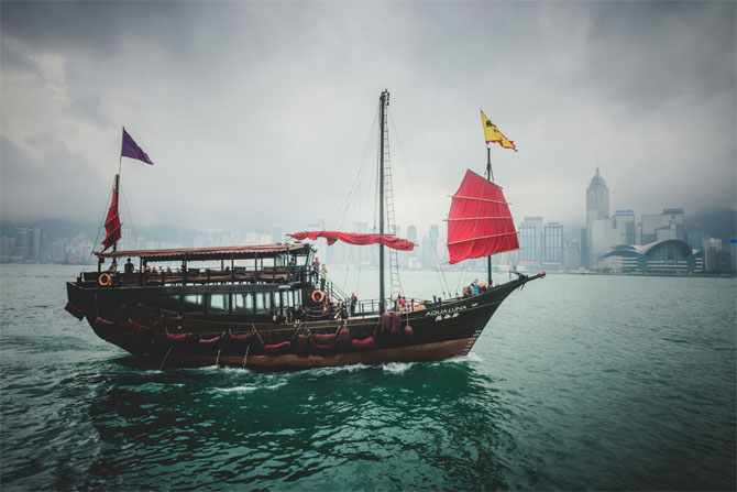 A lonely vessel passing the skyline of Hong Kong Island