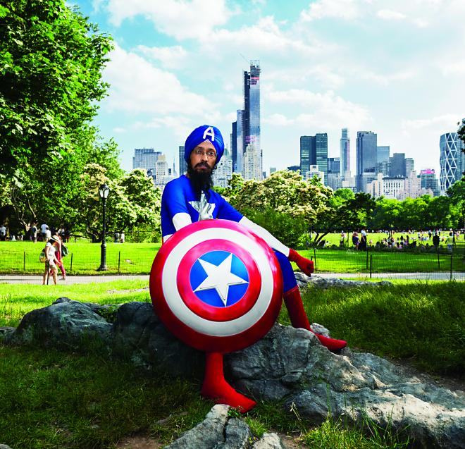 Vishavjit Singh, a New York-based Sikh cartoonist and creator of Sikhtoons, dressed as Captain America.