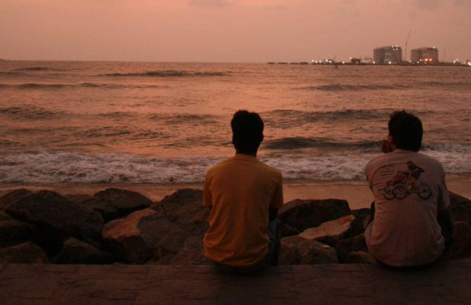 Tourists enjoying a beautiful sunset at Kochi