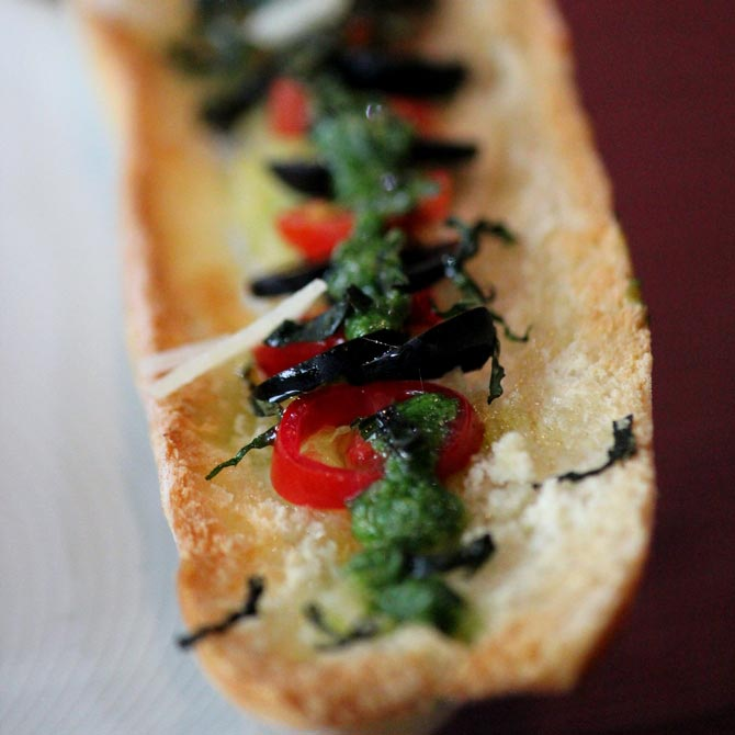 Crostini of cherry tomato and olives