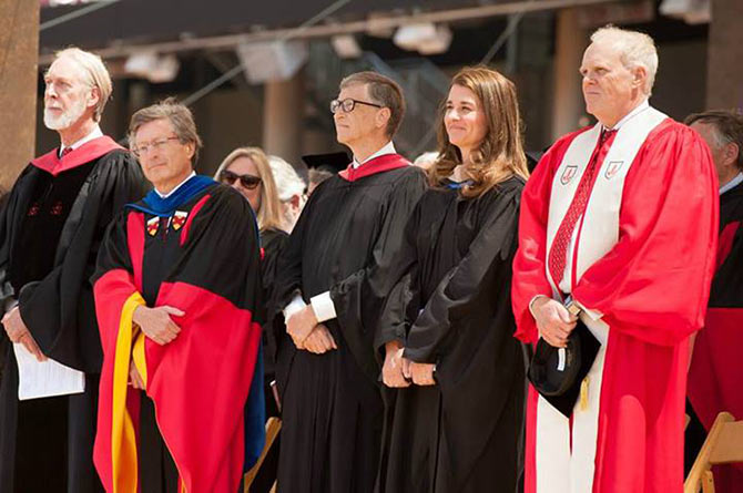 (LtoR)Dean for Religious Life at Stanford Rev Scotty McLennan,  Stanford Provost John Etchemendy, philanthropists Bill and Melinda Gates, and President John Hennessy at the commencement.