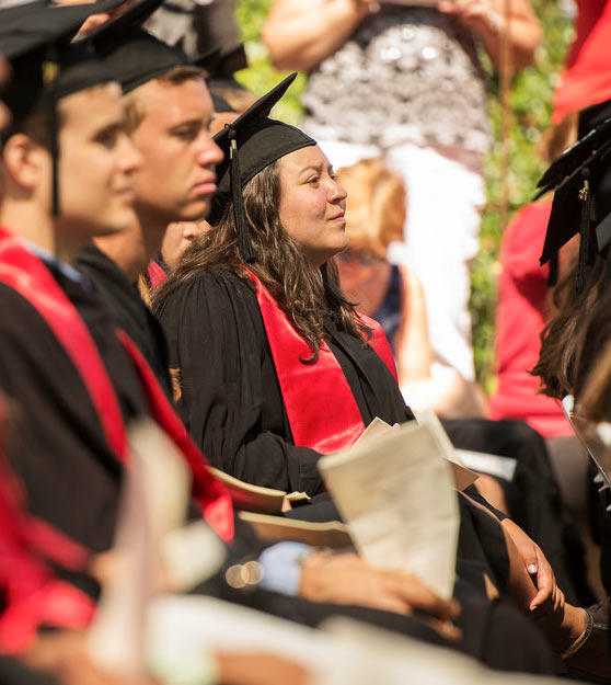 A Stanford graduate listens in as Bill Gates and Melinda Gates speak at the commencement on June 15, 2014