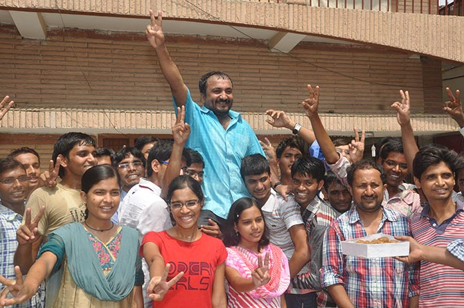 A jubilant Anand Kumar (in blue shirt) celebrates with his students in Patna.