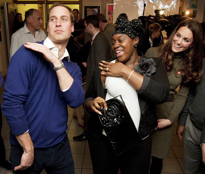 Prince William shows off his dance moves with Vanessa Boateng, an 18-year-old trainee nurse, as an amused Kate watches.