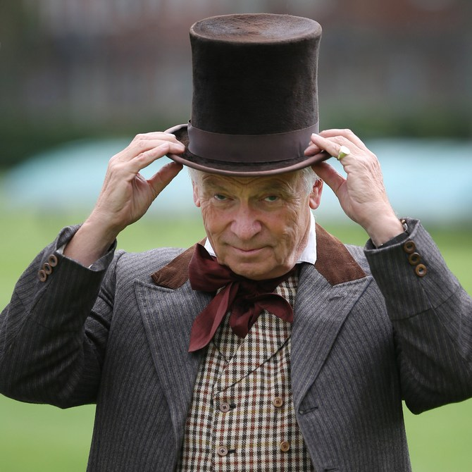 Umpire Lord Jeffrey Archer takes to the field for a Victorian cricket match at Vincent Square in London, England.