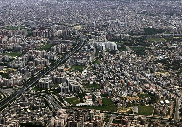 Buildings and roads are seen from the window of an airplane over New Delhi.