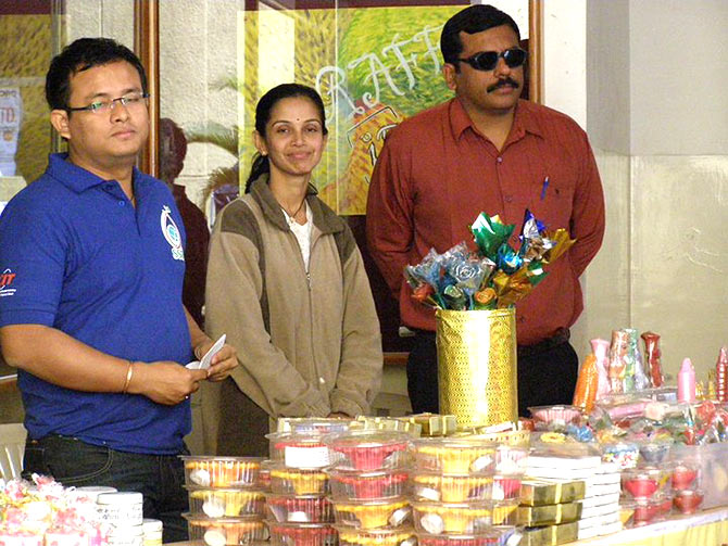 Bhavesh Bhatia with Neeta (centre) at a candle exhibition