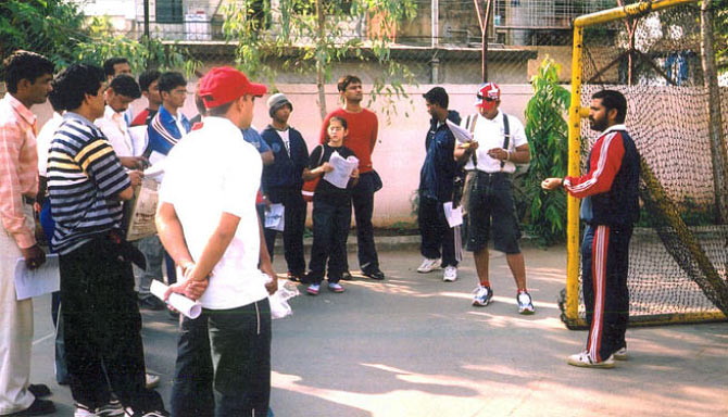 Raju Dabhade training students for Roll Ball