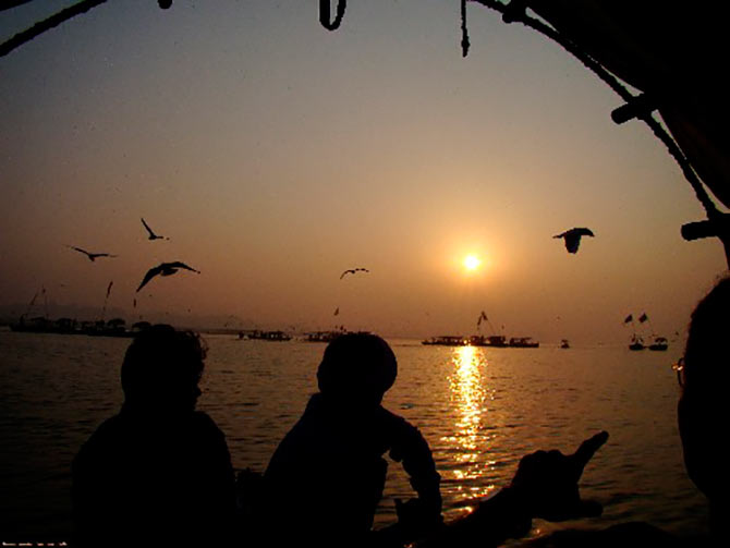 A picture of the rising sun taken from a boat at Triveni Sangam, Allahabad