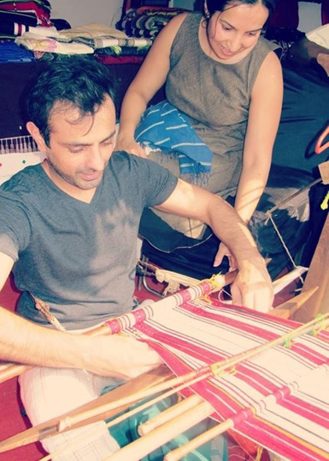 Mayank and Shraddha try their hand at weaving.
