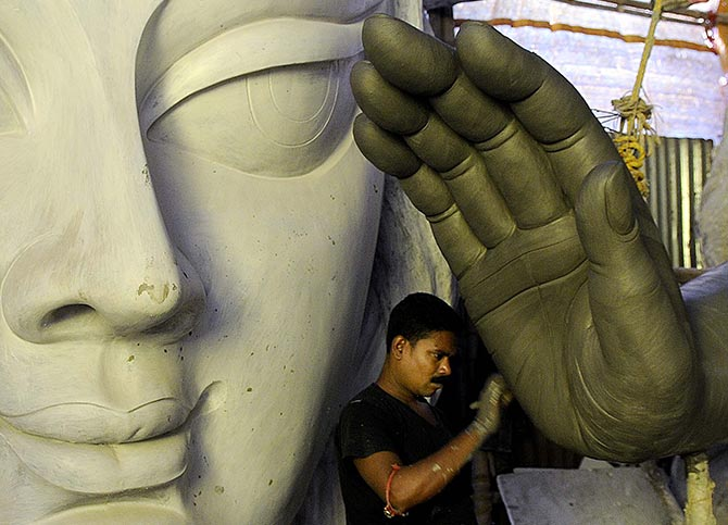 Durga idol being chiselled