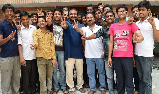Anand Kumar of Super30 celebrates with his students