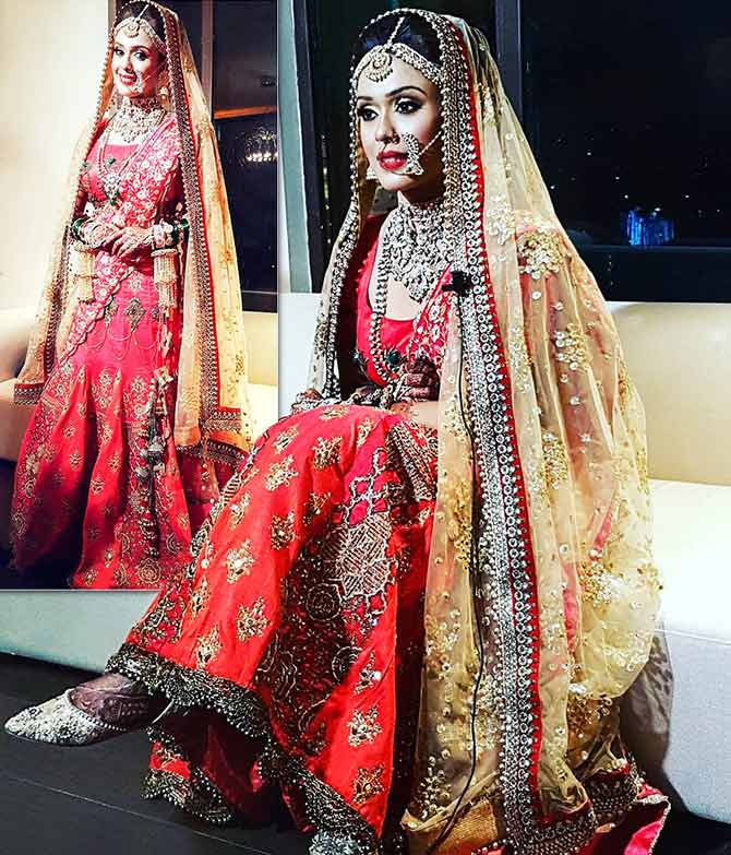 e0f075d38e3cea Hrishitaa Bhatt had a traditional wedding in Delhi. She looked gorgeous in  a coral embellished lehenga designed by Preeti Singhal.