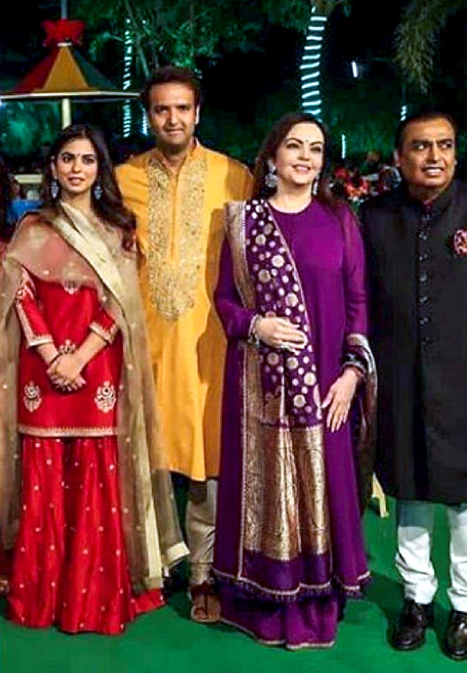 62a4c154ca8 Who dresses bride to-be Isha Ambani the best  IMAGE  Isha Ambani and Anand  Piramal with Nita and Mukesh Ambani. Photograph  Kind courtesy Lajjoo  C Instagram
