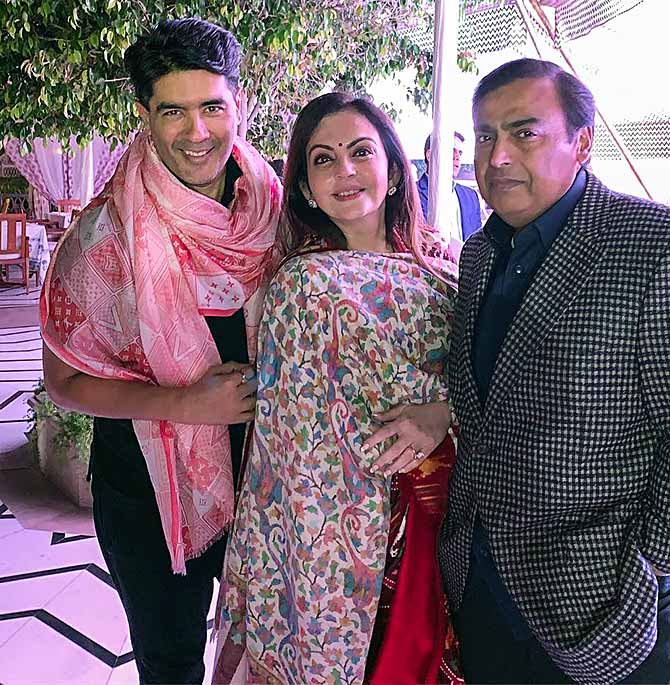 Nita and Mukesh Ambani with designer Manish Malhotra at their daughter Isha's pre-wedding festivities in Udaipur. Photograph: Manish Malhotra/Instagram