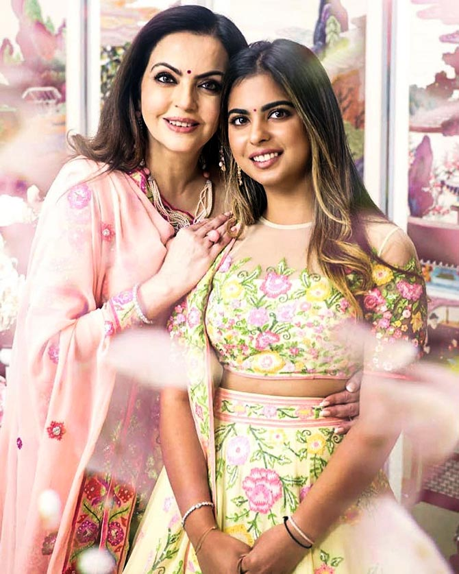 9f67460d975 Isha and Nita Ambani look stunning in hand-embroidered Abu Jani and Sandeep  Khosla separates. With minimal jewellery