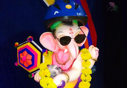 So cute! Ganesha wears a helmet