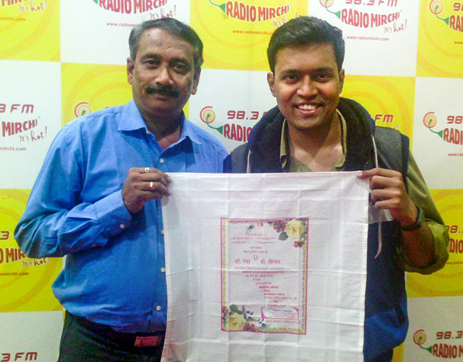 Uday Gadgil poses with the rumaal patrika he designed for his daughter Netra's wedding in 2016
