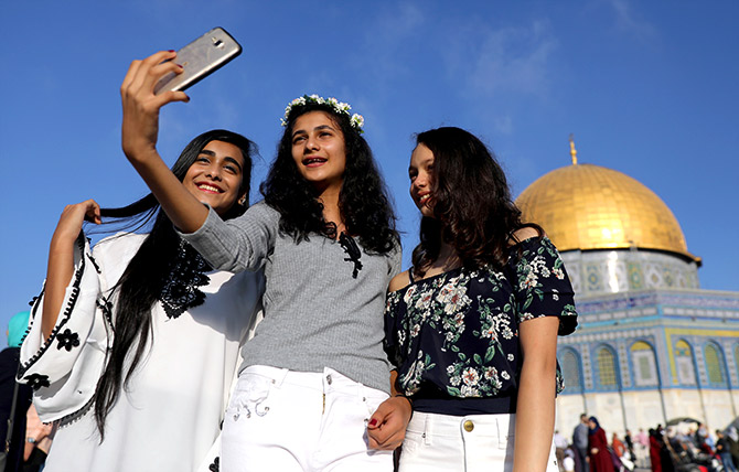Tourists take a selfie in Jerusalem