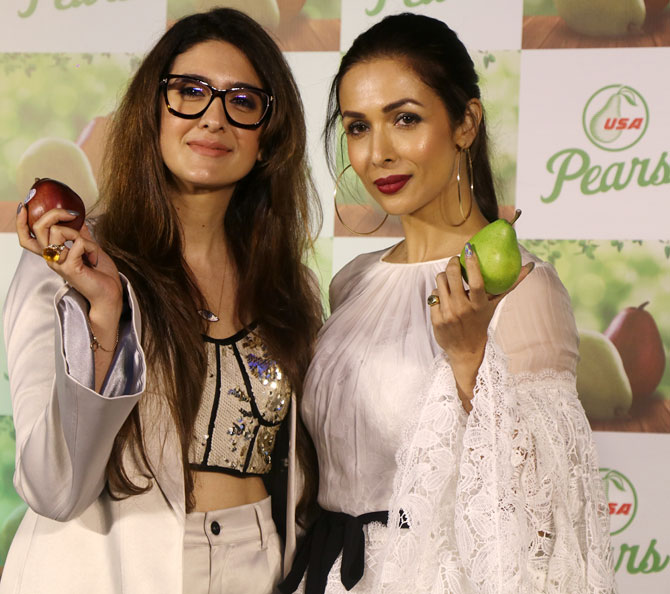 Pooja Makhija with Malaika Arora at the launch of USA Pears in Mumbai