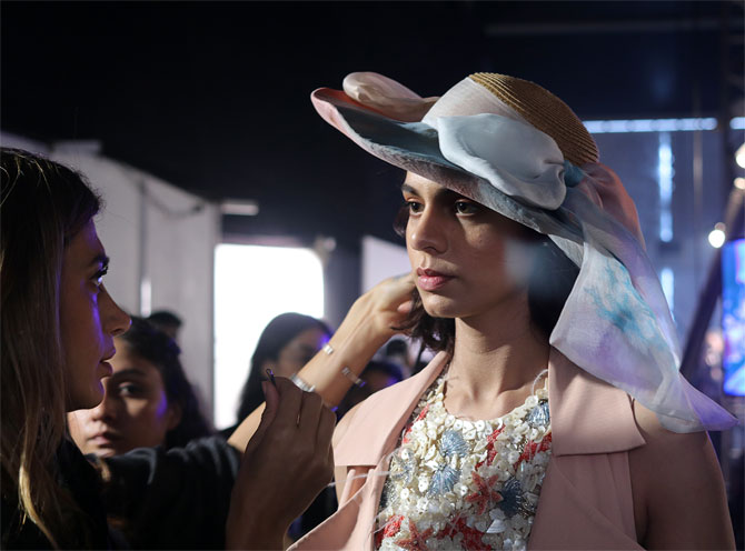 A stylist helps model Khushboo Kankan ahead of the show
