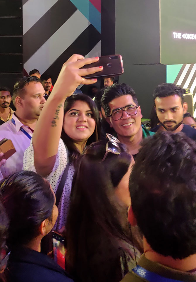 Manish was the only celebrity, till now, who stopped for selfies on his way out of the venue. Photograph: Kshamaya Daniel/Rediff.com.