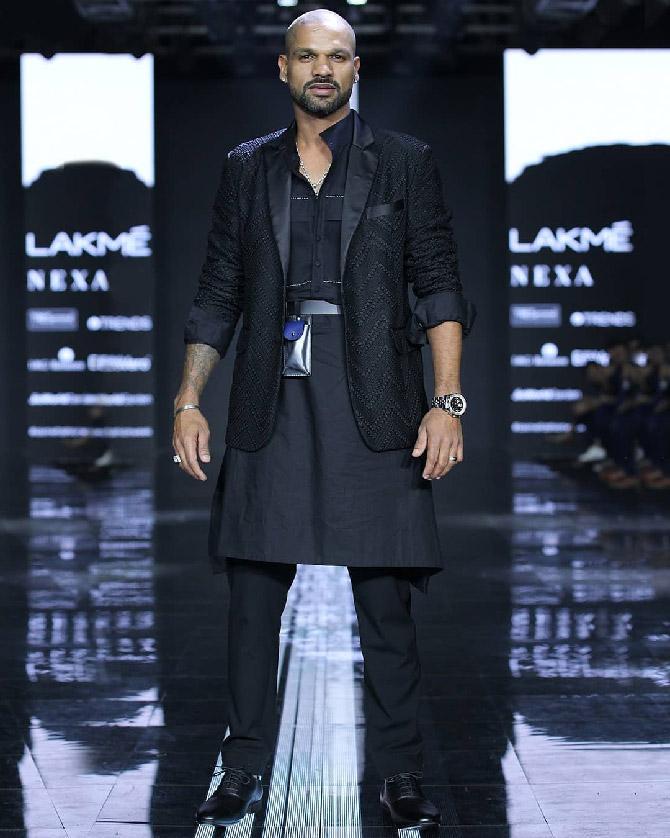 Shikhar Dhawan walks the ramp at Lakme Fashion Week