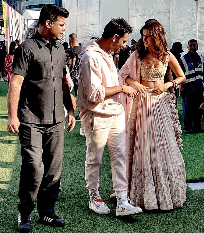 Tara Sutaria, Punit Balana and entourage walk from the runway to the celebrity green rooms Photograph: Kshamaya Daniel/Rediff.com.