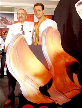 salman khan to endorse red tape shoes  rediff business