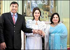 Usha Mittal (right) with L N Mittal and Simi Grewal (center).