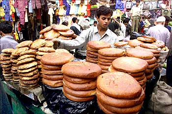 A man sells baked bread in Kolkata.