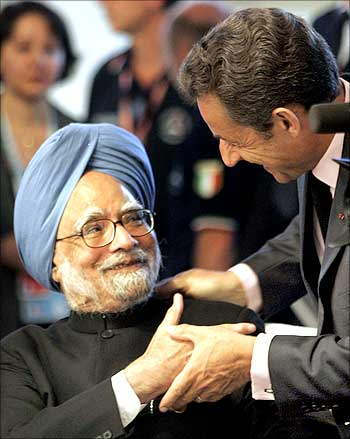 Prime Minister Manmohan Singh is greeted by France's President Nicolas Sarkozy during the G8 summit in L'Aquila, Italy.