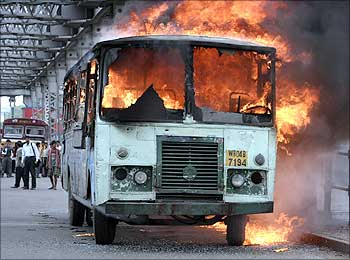 A passenger bus burns after it was set on fire by a mob during a protest in Kolkata.