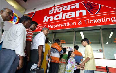 Passengers queue outside the Indian Airlines ticket counter at the domestic airport in Mumbai.