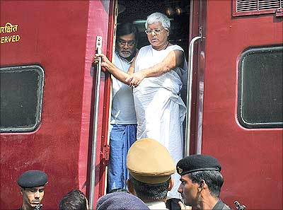 Railway Minister Lalu Prasad Yadav in conversation with Railway officials.