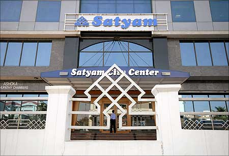 A Satyam employee enters the office building in Hyderabad.