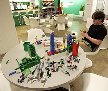 An employee plays with lego at the New York City office of Google.