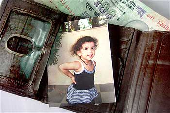 Why your wallet must have a baby's photo - Rediff.com Business