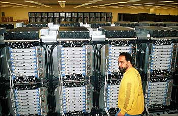 A technician inspects part of BlueGene/L at Lawrence Livermore laboratory in Livermore, California.