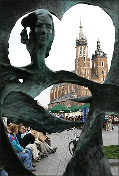A general view of St. Mary's Basilica is seen through a sculpture in Krakow, southern Poland.